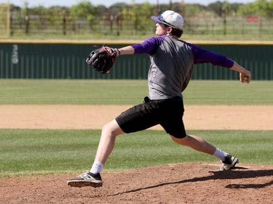 Jacksboro's Luke Dixon pitches during practice Tuesday, May 2, 2017, in Jacksboro.