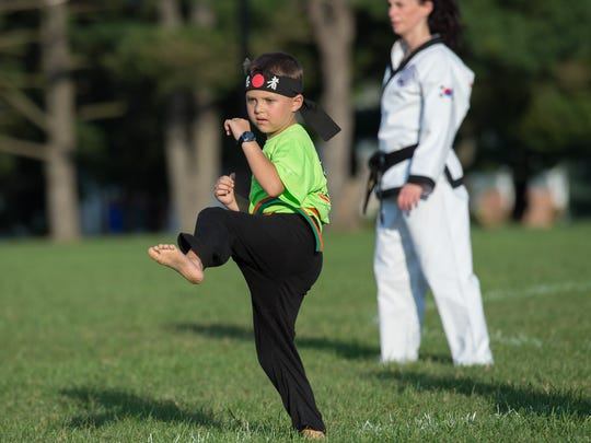 Second-grader Von Kleiv, 7, performs during a karate demonstration at Laps For Lymphoma fundraiser at Major George S. Welch Elementary School on Dover Air Force Base. Von was diagnosed with lymphoma in 2016.