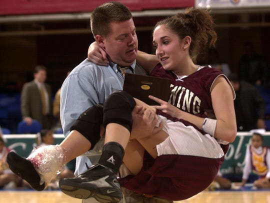 Ossining assistant coach JD Apostolico carried Melissa