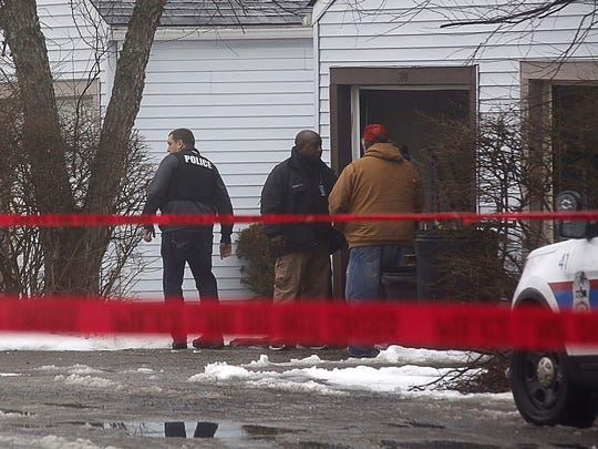 Police investigate the scene of a shooting in Westerville,