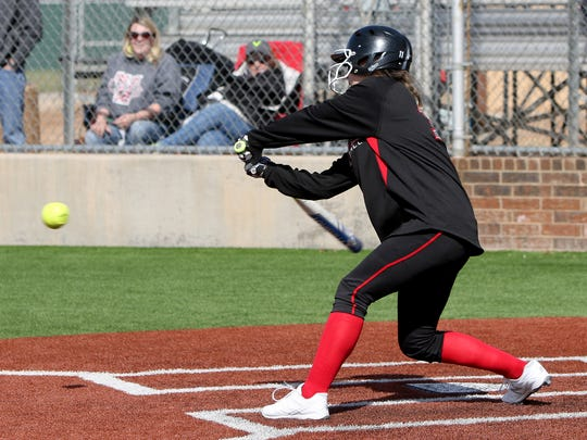 Wichita Falls High School's Kamryn Mitchell hits a single against Vernon Thursday, March 1, 2018, at Sunrise Optimist Softball Complex. The Lions defeated the Lady Coyotes 1-0.