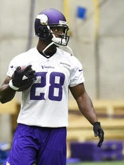 Minnesota Vikings running back Adrian Peterson works out Wednesday during practice in Eden Prairie.