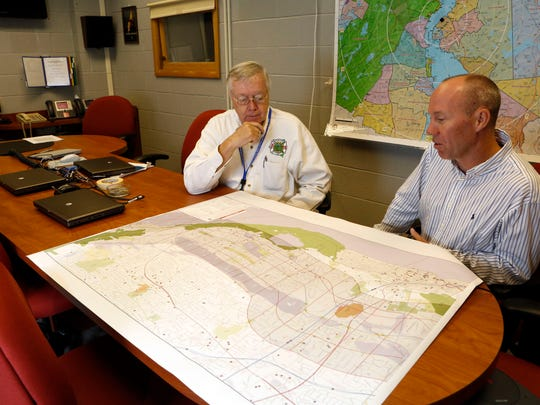 Gordon Wren Jr., left, director of Rockland's Office of Fire and Emergency Services, and hazardous materials coordinator Chris Jensen look over the draft evacuation map for an emergency involving a train carrying hazardous materials at the training center in Ramapo on July 31.