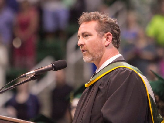 Principal Jason Schrock speaks at Howell High School's 2017 graduation ceremony.