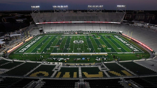 Players warm up on the field before the game at Canvas Stadium at Colorado State University in Fort Collins on Oct. 5, 2019.