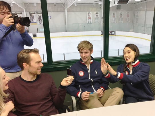 Ice dancers Evan Bates (middle) and Madison Chock (right) visit with their fellow #TeamNovi skaters and the media during the 2018 Olympic Send-Off Celebration at Novi Ice Arena.