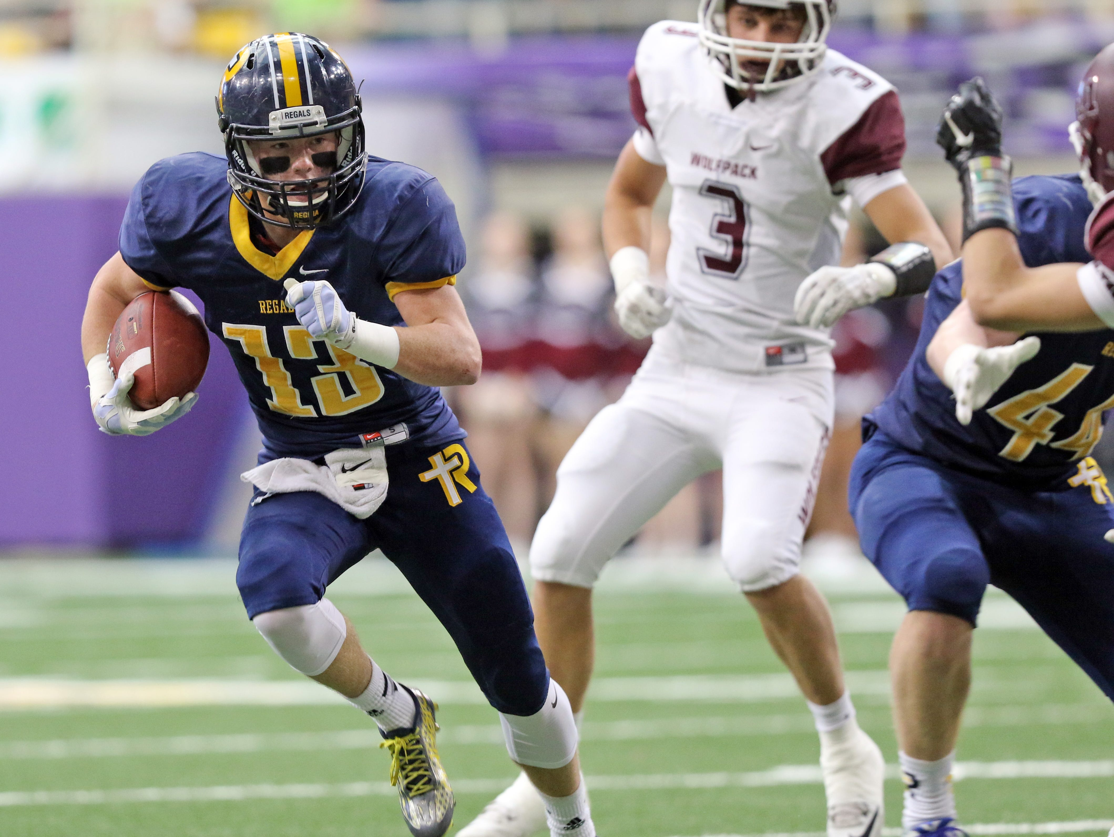 Ethan Suchomel of Iowa City Regina runs the ball in the Class 1A Championship game with Western Christian Hull Monday, Nov. 23, 2015.