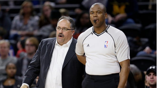 Detroit Pistons coach Stan Van Gundy, left, talks with referee Sean Wright during a game against the Chicago Bulls on Monday, Jan. 18, 2016, in Auburn Hills.