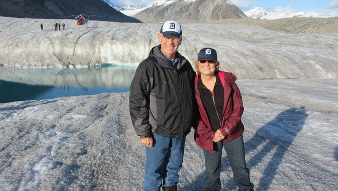 On a visit to Alaska, Gregory and Kathleen Grzybowski of Troy sport the Old English D atop a glacier, where they landed with help from a helicopter.