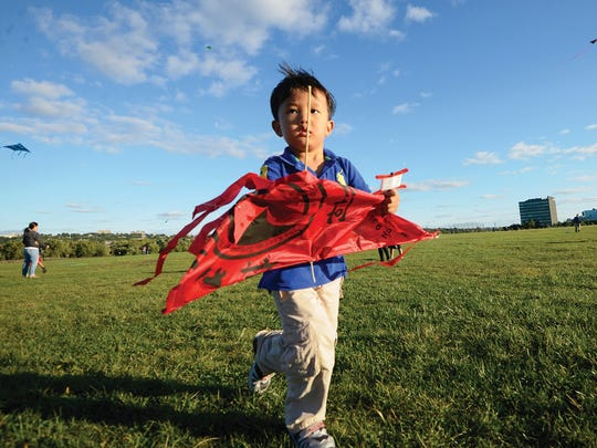 Three-year-old James Jung of Fort Lee running his kite