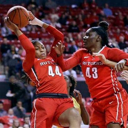 Rutgers forward Betnijah Laney grabs a rebound in traffic