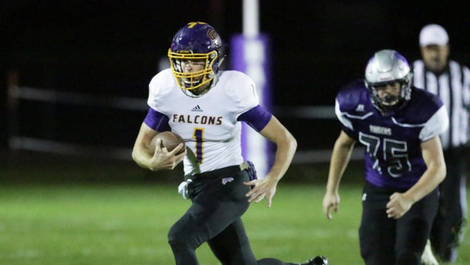 Sheboygan Falls' Jared Petrie (1) carries the ball against Kiel on Friday.