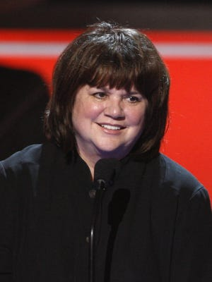 Linda Ronstadt accepts the Trailblazer award at the National Council of La Raza ALMA Awards in Pasadena, Calif. Ronstadt broke barriers for women as one of the top-selling artists of her generation. She has revealed she has Parkinson's Disease.