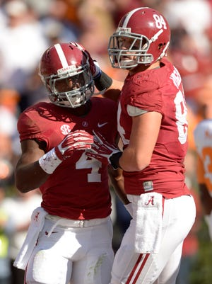 T.J. Yeldon (4) rushed for three TDs as Alabama improved to 8-0.