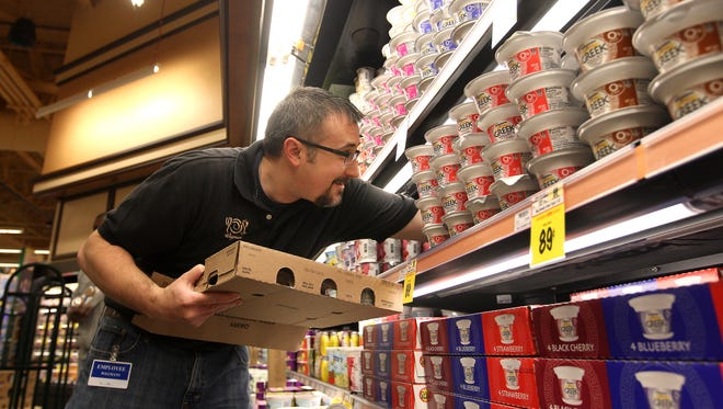Jason Vaningen of Geneseo stocks shelves at Wegmans with yogurt.