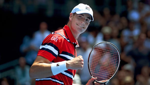 John Isner celebrates after defeating Feliciano Lopez