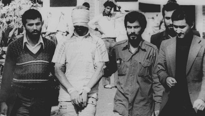 One of 60 American hostages held by Iran.