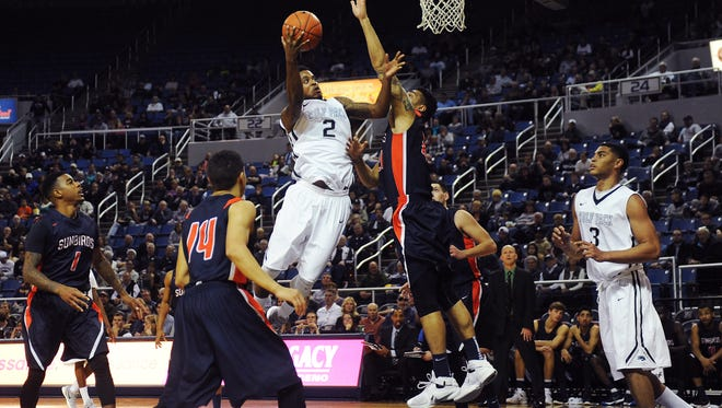 Nevada's Tyron Criswell (2) goes in for a layup against Fresno Pacific during their basketball game at the Lawlor Events Center in Reno on Dec. 9, 2015.