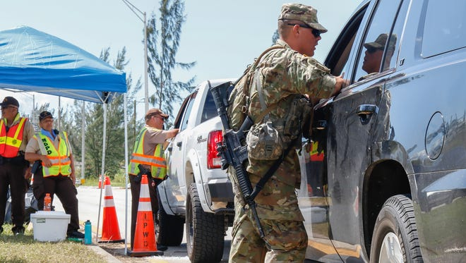 Sgt. Wade Blaylock, a team leader with Company B, 1-128th Infantry, 32nd Infantry Brigade Combat Team, conducts entry control point operations in southern Florida last September after the Wisconsin National Guard was called up to assist after Hurricane Irma hit the state.