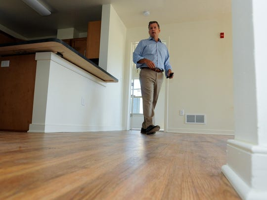 Ingerman Development Principal David Holden does a walk through of a three bedroom unit at the old Cleveland Heights public housing facility in Newark Thursday, September 17, 2015. The new facility is comprised of 56 units and is scheduled to be completed in October.