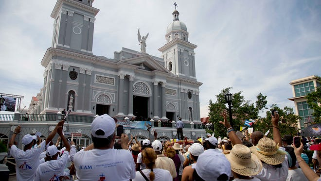 People gather outside the Metropolitan Cathedral as Pope Francis arrives to bless families in Santiago de Cuba, Cuba, on Sept. 22, 2015.