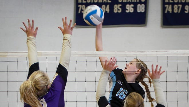 Lansing Catholic's Becka Poljan scores over Fowlerville defenders Erin Vielbig and Jordan Dragonov October 14, 2015 at Lansing Catholic.  Lansing Catholic won 3-0.  [MATTHEW DAE SMITH | for the Lansing State Journal]
