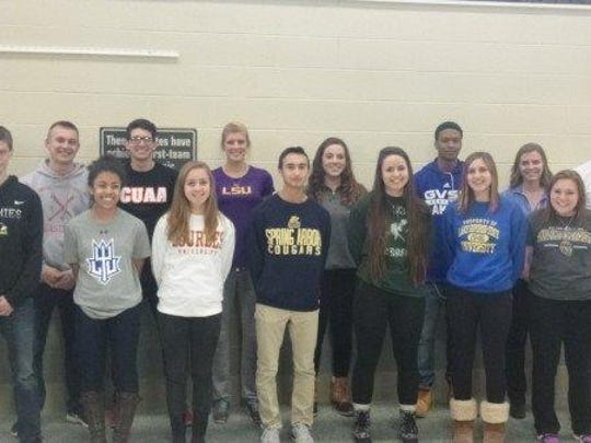 An impressive group of Plymouth High School student-athletes poses for a photo after National Signing Day festivities. At far right is Plymouth athletic director Kyle Meteyer.