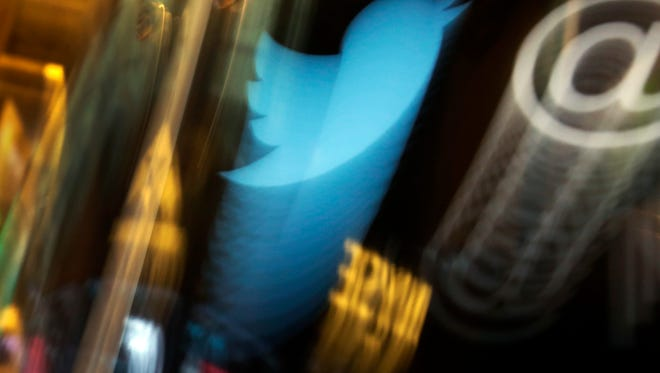 In this Wednesday, Nov. 6, 2013, file photo, the Twitter logo appears on an updated phone post on the floor of the New York Stock Exchange. Twitter reports financial results Thursday, Oct. 27, 2016.