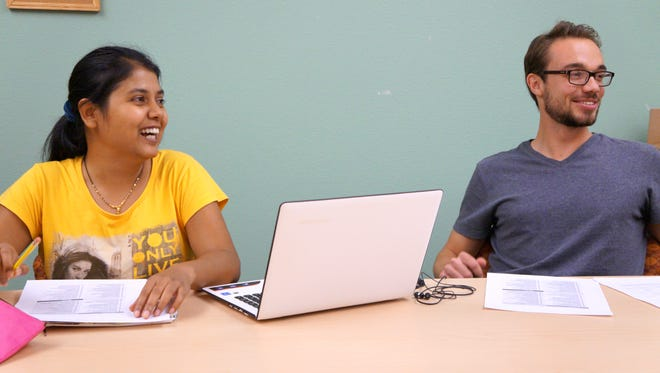 Computer science graduate student Shubhasmita Pati (left) and education graduate student Germain Degardin participate in a team building exercise during their regular SOAR Lab meeting. Students in the lab work with program directors at NMSU outreach programs to research the impact of each program and help improve them.