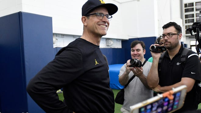 Michigan football head coach Jim Harbaugh addresses the media during a break at the Michigan Aerial Assault QB Camp.