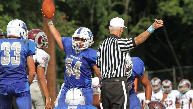 Middlesex's Joseph Choukair (54) has recoverd a fumble in game against South River at home.