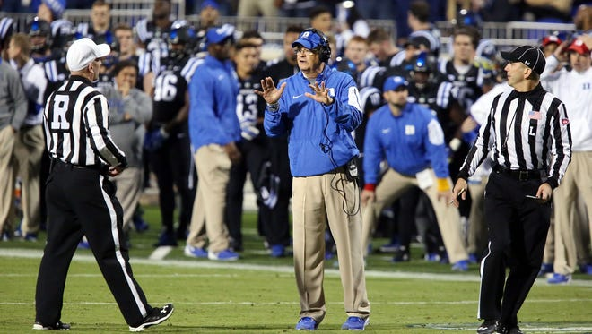Duke head coach David Cutcliffe gets an explanation from ACC officials on a call in the Blue Devis' loss to Miami.