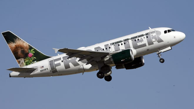 A Frontier Airlines takes off from Denver International Airport in 2007.