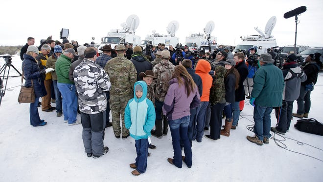 People gather as Ammon Bundy speaks with reporters at Malheur National Wildlife Refuge headquarters on, Jan. 4, 2016, near Burns, Ore.