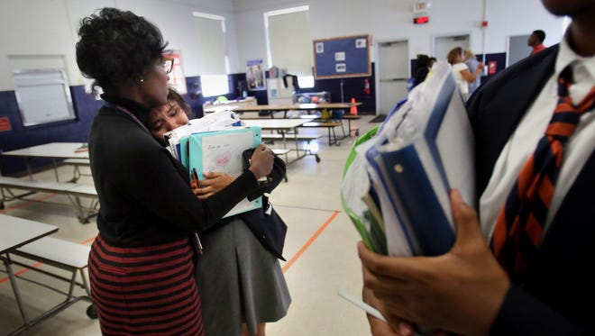 Kristle Hodges-Johnson, principal at Freedom Preparatory, comforts a student Nov. 9 after a group of students and faculty met to discuss the results of the presidential election.
