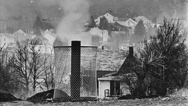 Smoke rises from the ground in Centralia, Pa., on Jan. 26, 1983, where an uncontrolled underground mine fire that started on May 27, 1962, still rages.