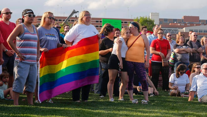 """Hundreds gathered to show support for the LGBTQ community on Tuesday, June 14, 2016, at the Pappajohn Sculpture Park in Des Moines. The group One Iowa hosted the """"Love is Love is Love"""" gathering at the park to pay respects to the victims of the mass murder at a nightclub in Orlando recently."""