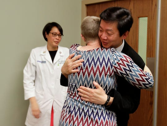 Terri Alleman, a special education teacher from Casper, Wyo., hugs Dr. Yee Chung Cheng after she completes her cancer treatment at the Clinical Cancer Center at Froedtert Hospital recently.