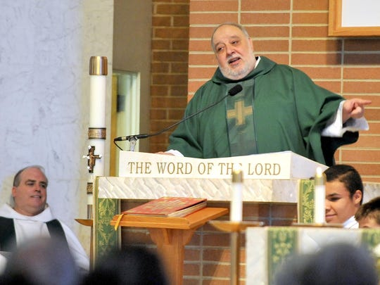 Father Saporito delivers his sermon during his last mass as the pastor of Saint Padre Pio parish, Sunday, Jun. 28, 2015 in Vineland.