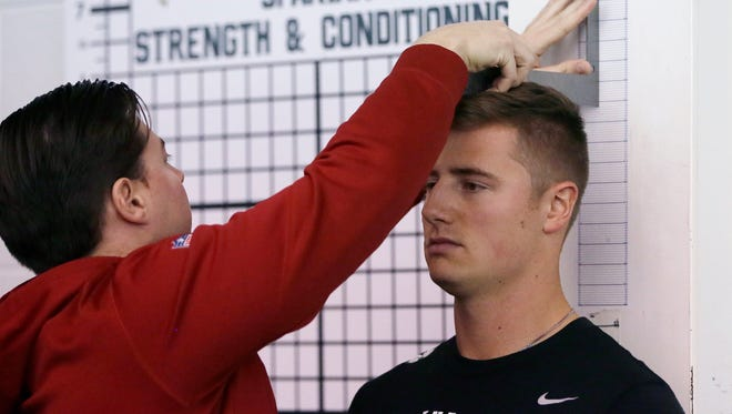 Quarterback Connor Cook is measured before working out for NFL scouts at his pro day March 16, 2016, in East Lansing.
