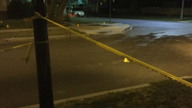 Evidence markers throughout the scene of a shooting at Melville and Denver streets in Rochester late Thursday night.