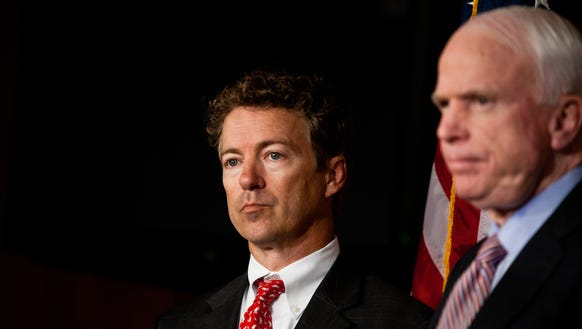 Sens. Rand Paul, R-Ky., left, and John McCain, R-Ariz.,