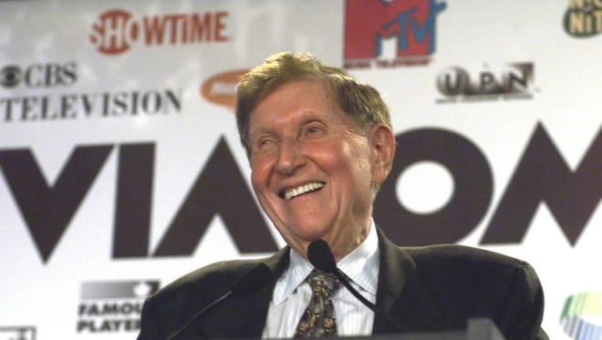 Sumner Redstone grins at the 1999 news conference announcing Viacom's triumphant $36-billion merger with CBS, arguably the high point of the mogul's varied media exploits.
