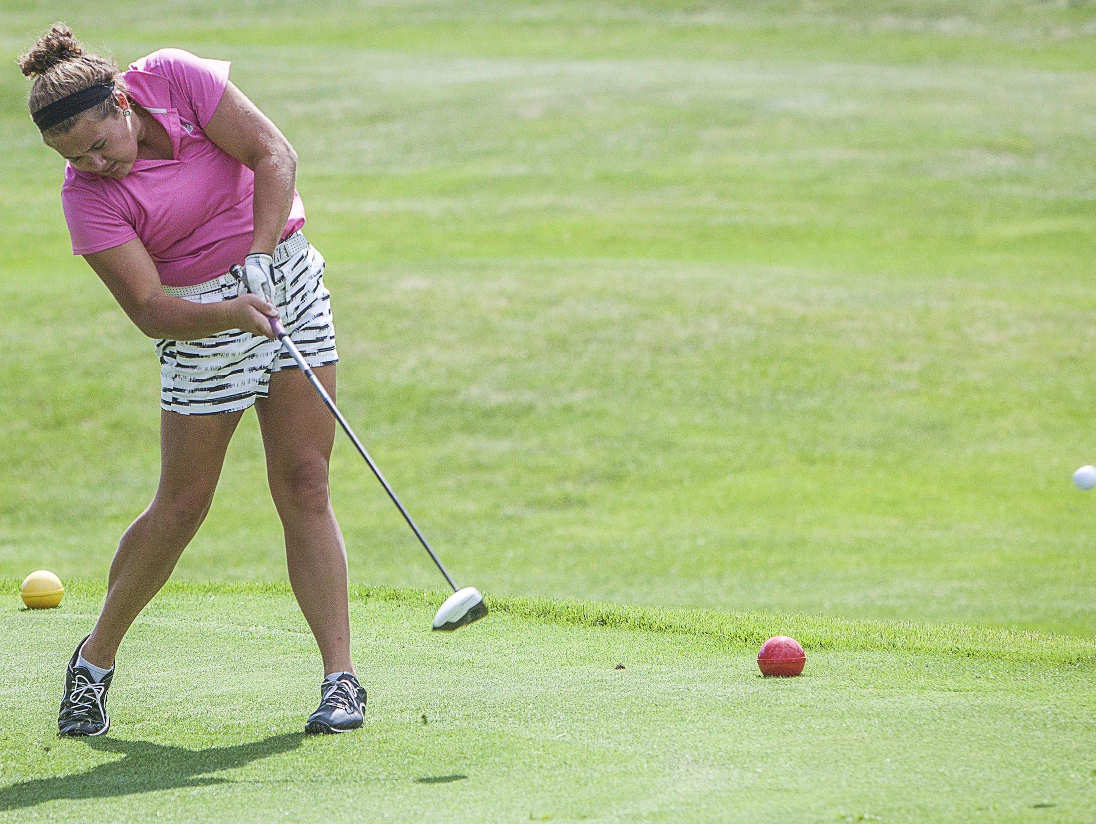 Holly Haynes follows through on a tee shot Tuesday.