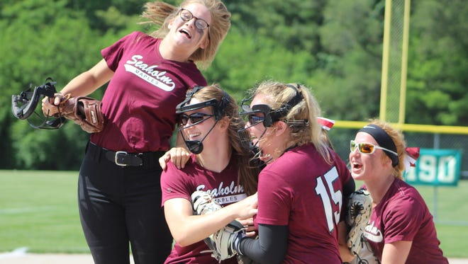 Birmingham Seaholm softball players celebrate their second consecutive Division 1 district championship Saturday afternoon.
