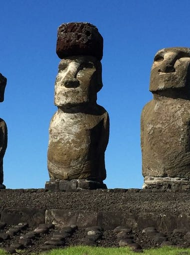 Moai statues on Easter Island, one with Pukao top knot.