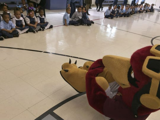 Ace the Warhawk, the University of Louisiana at Monroe mascot, keeps students entertained before an assembly Wednesday at Our Lady of Fatima School.