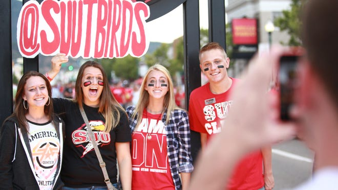 Students pose for a photo during Southern Utah University's 'Paint the Town Red' event, Thursday, Aug. 27, 2015.