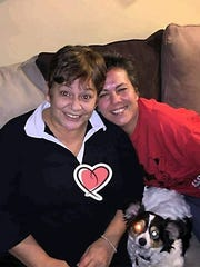 Dona Lawrence, left, is shown with her daughter Renee Lawrence in an undated family photo. Dona Lawrence, 61, was beaten to death Aug. 10 in her Warren apartment.