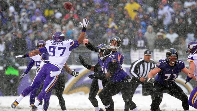 Baltimore Ravens quarterback Joe Flacco throws a pass over Minnesota Vikings defensive end Everson Griffen.